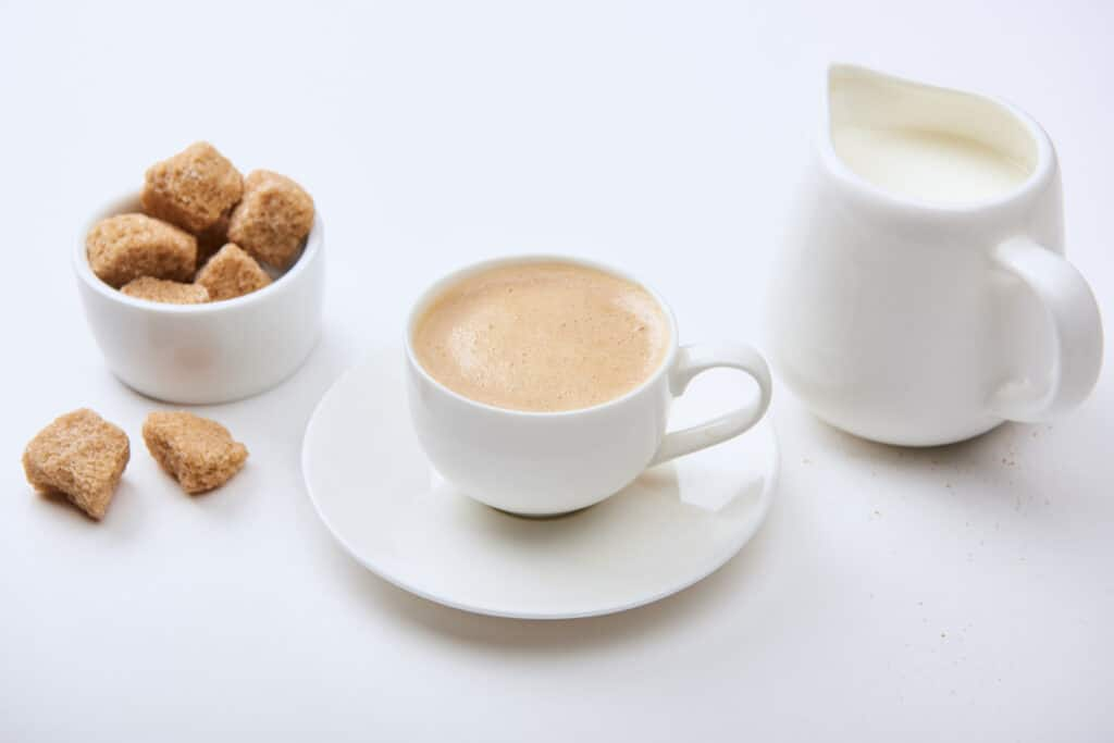 Coffee with milk and sugar, served in white china.